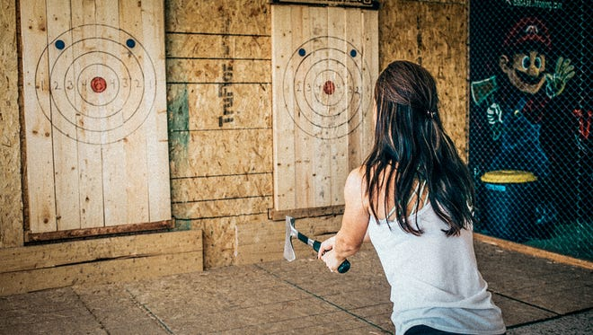 Bad Axe Throwing in Indianapolis is one of multiple axe-throwing venues that have opened in the U.S. recently.