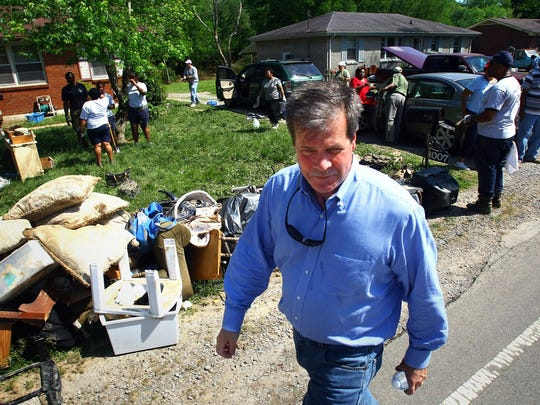 Nashville Mayor Karl Dean visits with residents on West Hamilton Road shortly after the May 2010 flood.