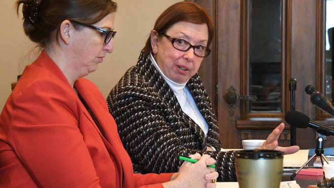 Democrat members of the Michigan Board of Canvassers Jeannette Bradshaw and Julie Matuzak (right) look less-than-enthused as Republican member Colleen Pero suggests a recess while waiting for a court in Detroit to rule on the recount in progress on Wednesday, Dec 7, 2016 at the Capitol in Lansing.