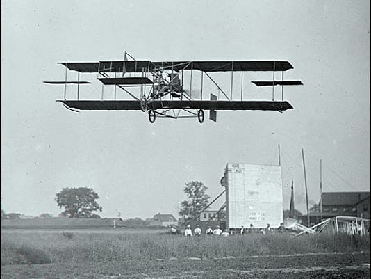 Curtiss Biplane in Flight over a Field (1909 Photo from Library of Congress, Prints and Photographs Division)