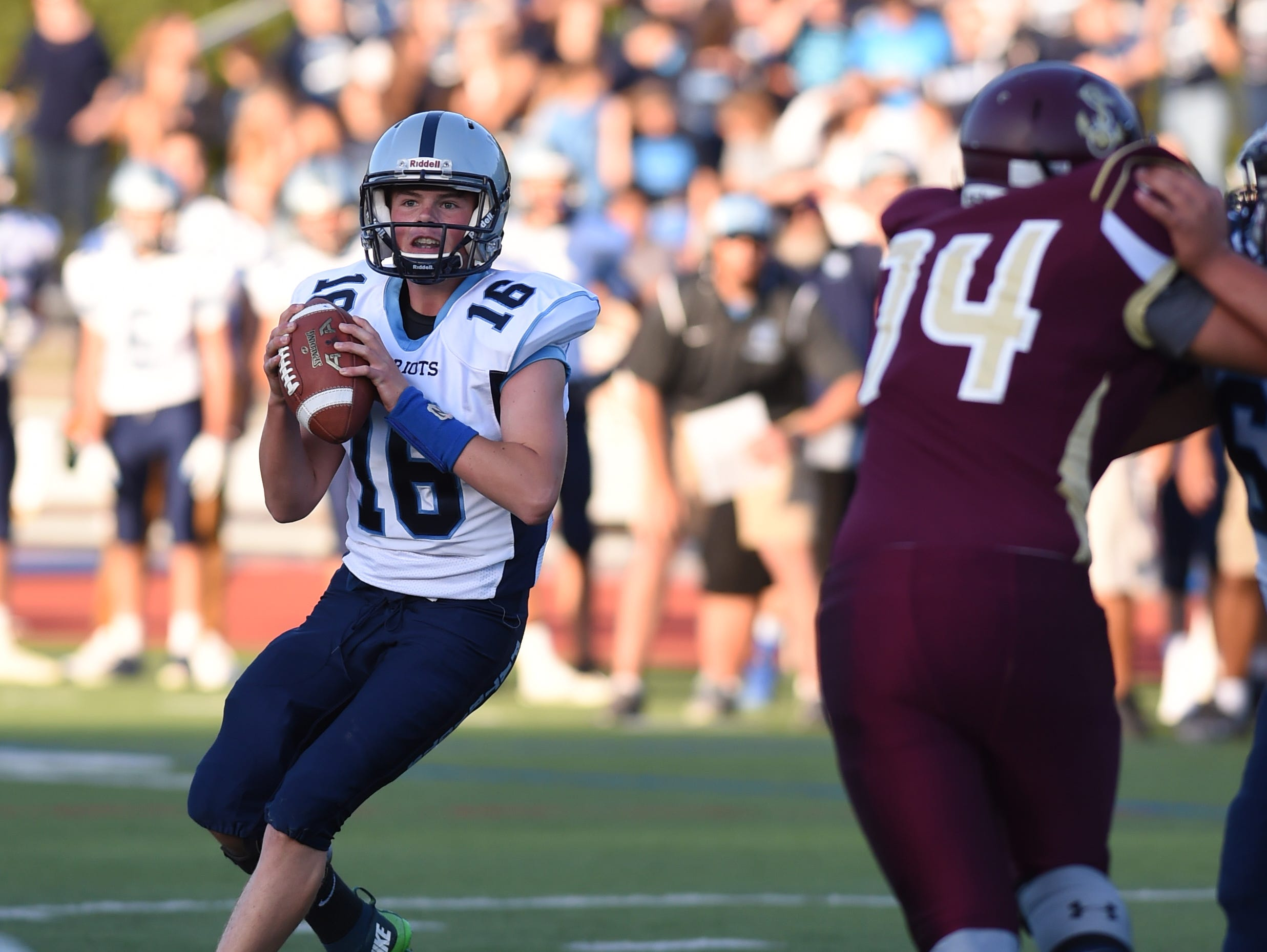 John Jay's Richie Eletto looks to pass the ball during Friday's game versus Arlington.