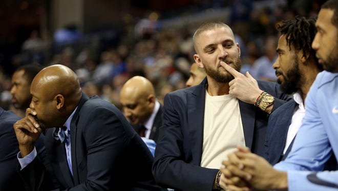 Grizzlies forward Chandler Parsons converses with guard Mike Conley on the bench during the first half against the Washington Wizards on Jan. 5.
