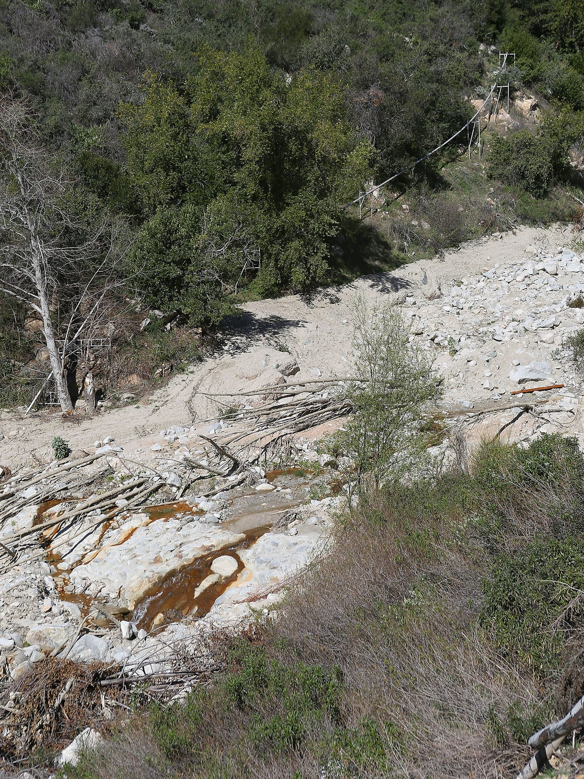 A water pipeline runs alongside Strawberry Creek in the San Bernardino National Forest. The pipe carries water from Arrowhead Springs to be bottled by Nestle.