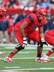 Arizona tackle Fabbians Ebbele lines up during a game against Oregon in Tucson, Ariz., in November 2013.