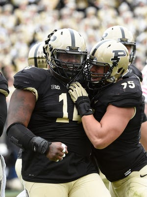 Purdue Boilermakers defensive tackle Ra'Zahn Howard (14) celebrates after a sack against.