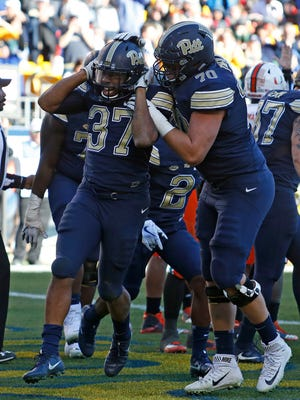 Qadree Ollison of the Pittsburgh Panthers celebrates his 5-yard rushing touchdown in the second half.