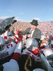 Earle Bruce is carried off the field after winning