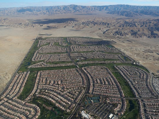 Homes and golf courses at Sun City Palm Desert are surrounded by undeveloped desert in this aerial view, March 26. 2018.