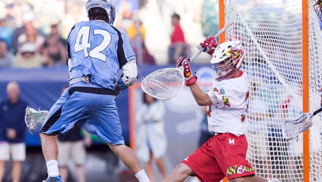 Maryland Terrapins goalie Kyle Bernlohr (35) makes a save on Johns Hopkins Blue Jays attacker Wells Stanwick (42) during the fourth quarter in the semifinals of the NCAA division I men's lacrosse championships at Lincoln Financial Field.