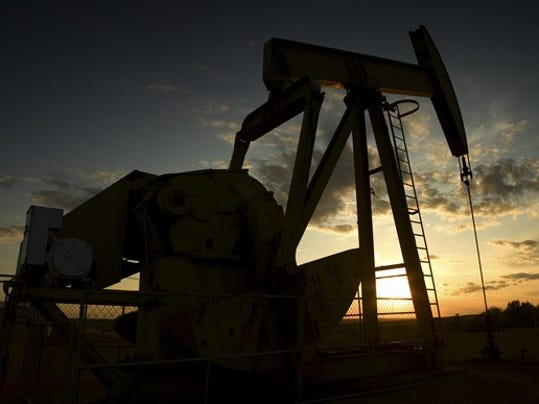 oil-derrick-sunset_large.jpg