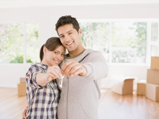 couple-buying-a-house-holding-key-getty_large.jpg