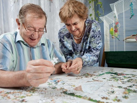 retired-couple-doing-a-puzzle_gettyimages-123466624_large.jpg