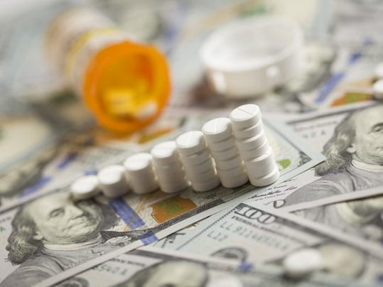prescription-drug-pills-stacked-on-hundred-dollar-bill-getty_large.jpg