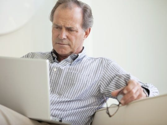 serious-senior-using-laptop-social-security-getty_large.jpg