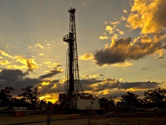 land-drilling-rig-at-sunset_large.jpg