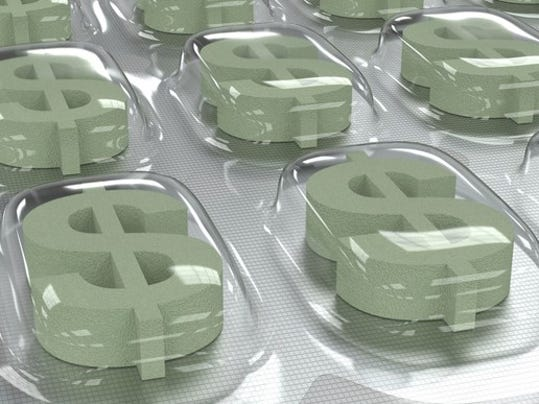 prescription-drug-dollar-symbol-pills-in-package-getty_large.jpg