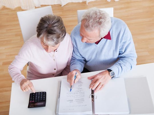 retired-couple-with-calculator_gettyimages-178780384_large.jpg