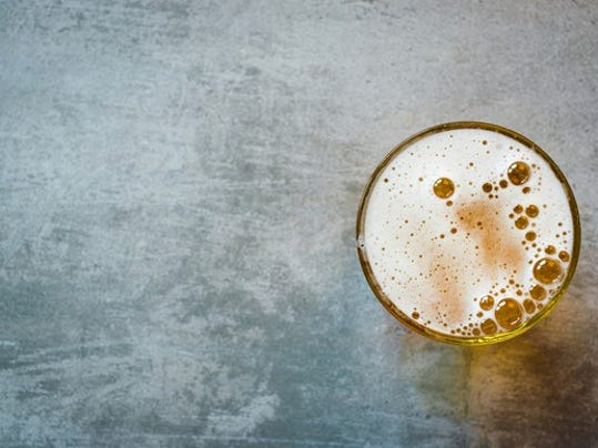 rsz_glass_of_beer_on_a_concrete_table_large.jpg