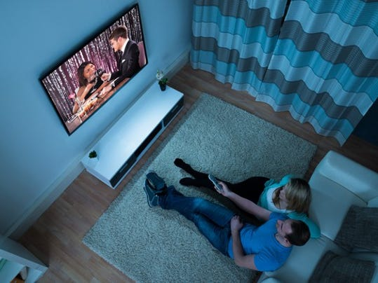 couple-watching-tv-in-living-room_large.jpg