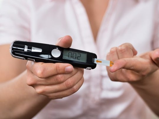 woman-with-glucometer-diabetes-testing-blood-getty_large.jpg