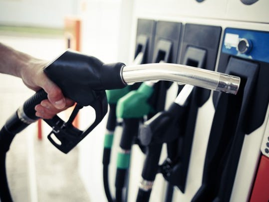 getty-gas-pump-with-hand_large.jpg