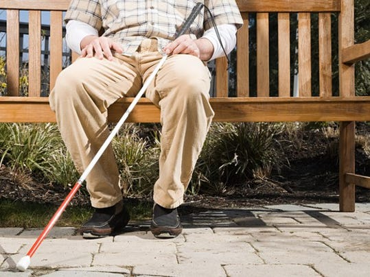 blind-man-sitting-on-a-bench_large.jpg