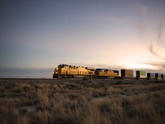 a-cargo-train-travelling-through-the-desert_large.jpg