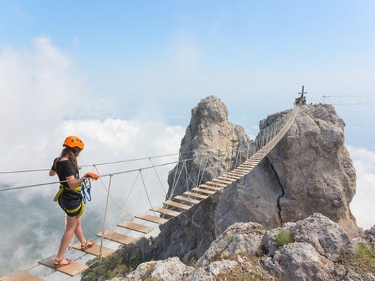 young-woman-crossing-bridge-over-abyss_large.jpg