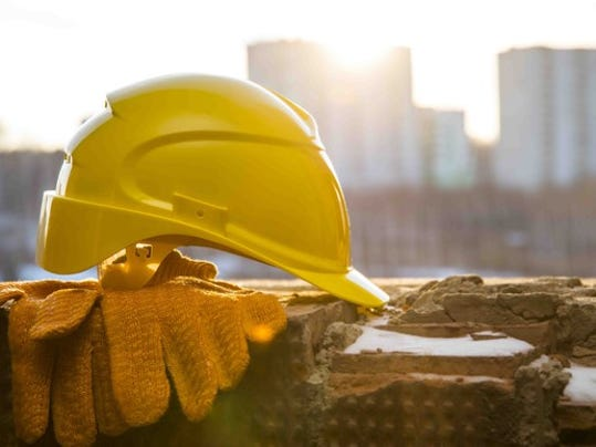 a-yellow-hard-hat-sitting-on-top-of-gloves-on-a-ledge_large.jpg