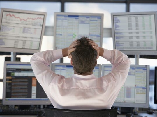stock-trader-frustrated-by-losses-looking-at-stocks-getty_large.jpg