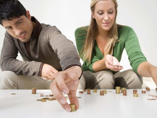 couple-counting-coins-and-saving-money-budgeting-getty_large.jpg