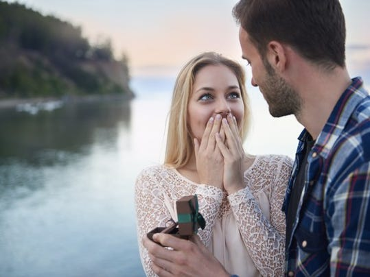 young-man-proposing-to-young-woman-proposal-marriage-engagement-wedding-ring_large.jpg