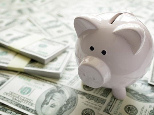 piggy-bank-on-a-pile-of-money_gettyimages-509558516_large.jpg