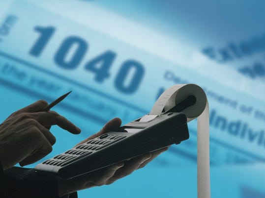 calculating-taxes-1040-calculator-getty_large.jpg