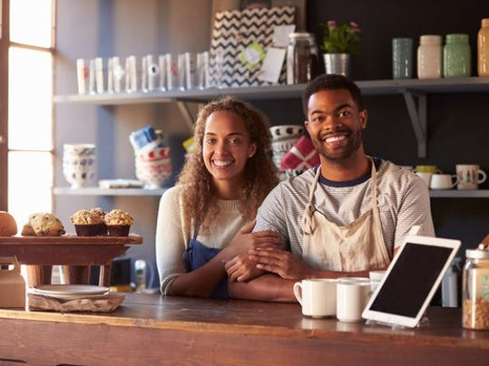 couple-standing-behind-coffee-shop-counter-small-business-owner-entrepreneur-poc_large.jpg