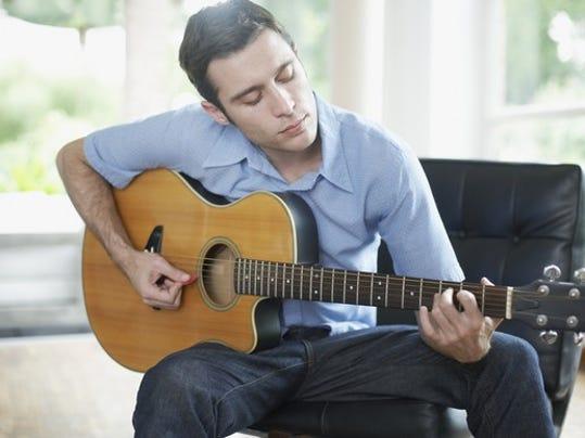 man-playing-guitar_gettyimages-81725010_large.jpg