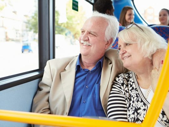 senior-couple-looking-out-a-bus-window_gettyimages-466691945_large.jpg