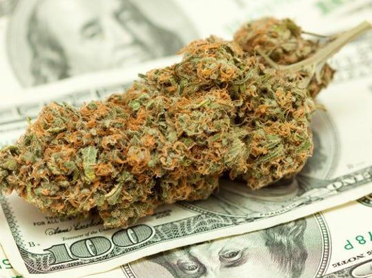 marijuana-cannabis-bud-on-top-of-hundred-dollar-bill-getty_large.jpg