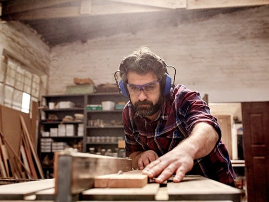 man-cutting-wood-in-a-workshop_gettyimages-512543232_large.jpg