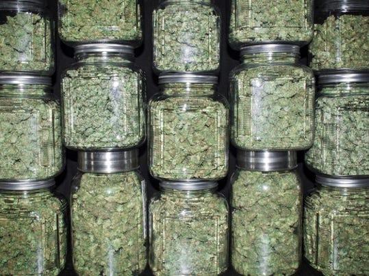 marijuana-cannabis-buds-stacked-in-jars-getty_large.jpg