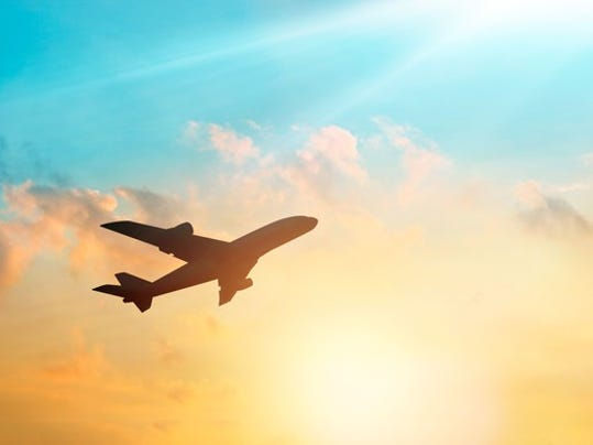 airplane-flying-with-sun-in-background_large.jpg