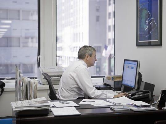 man-working-at-desk_gettyimages-83121902_large.jpg