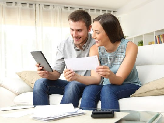 couple-smiling-and-reviewing-paperwork_gettyimages-623211758_large.jpg