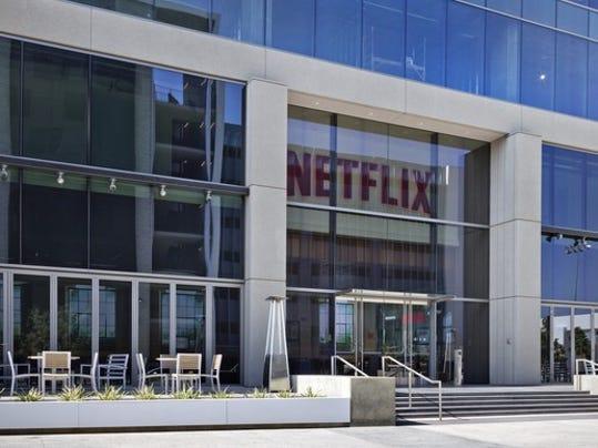 netflix reels in customers after price hike  sending stock