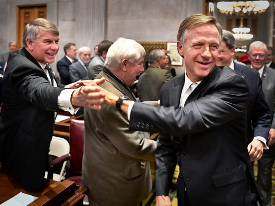 Gov. Bill Haslam shakes hands with Sen. Ed Jackson, R-Jackson, and other lawmakers as he makes his way to the podium to deliver his State of the State address at the Tennessee State Capitol on Jan. 29, 2018, in Nashville.