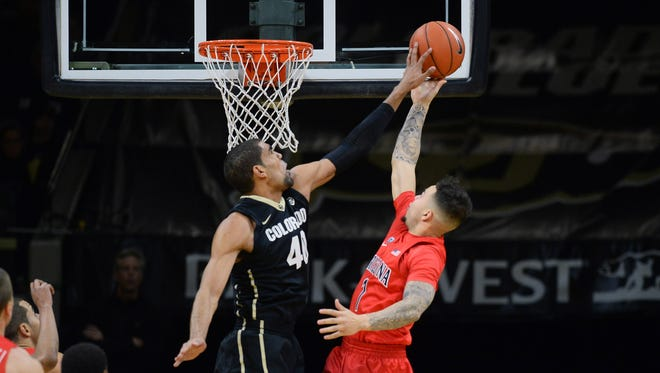 Feb 24, 2016; Boulder, CO: Colorado Buffaloes forward Josh Scott (40) blocks a shot by Arizona Wildcats guard Gabe York (1) in the first half at the Coors Events Center.