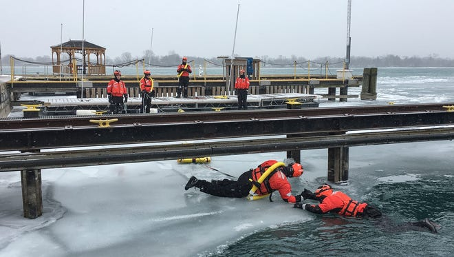 United States Coast Guard Seaman Saul Flores rescues Petty Officer Aaron OÕMara during an ice rescue demonstration at Station Belle Isle on Saturday, Feb. 3, 2018.