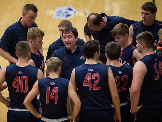 Heritage Hills' head coach Nate Hawkins talks with