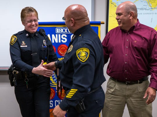 Corpus Christi Police Senior Officer Samantha Baldwin (from left) is congratulated by Police Chief Mike Markle and Mike Silva, president of the Corpus Christi Chapter of Kiwanis Club International, after the club presented Baldwin with the club's Police Officer of the Year award at the Congressman Solomon P. Ortiz International Center on Thursday, April 26, 2018.