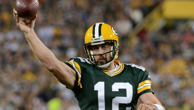 Green Bay Packers quarterback Aaron Rodgers (12) throws an incomplete pass in the first quarter. The Green Bay Packers hosted the Seattle Seahawks at Lambeau Field in Green Bay, Wis. on Sunday, Sept. 20, 2015.